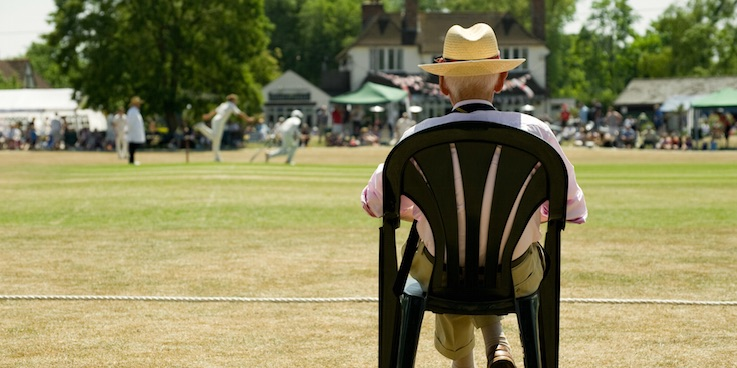 Old man watching cricket