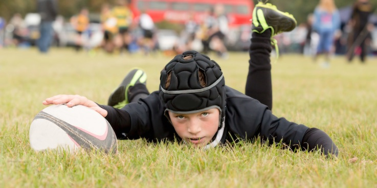 Boy playing rugby